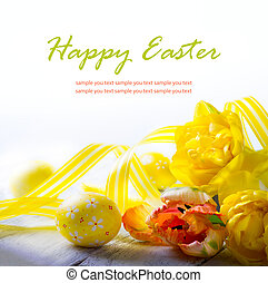art easter eggs and yellow spring flower on white background
