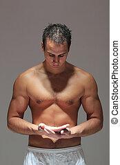 Muscular man torso with open hands
