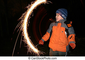 child with moving sparkler 2