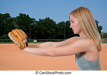 Woman Baseball Player - Beautiful woman catchinging a...