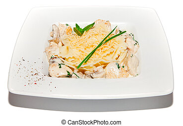 Pastai with chicken, creamy sauce and cheese, salad on plate