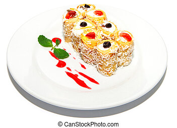 Cake roll with curd cream, berry and syrup, sweet dessert on...