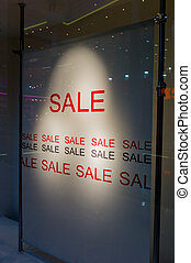sale in the commercial - in a display window of a store is...