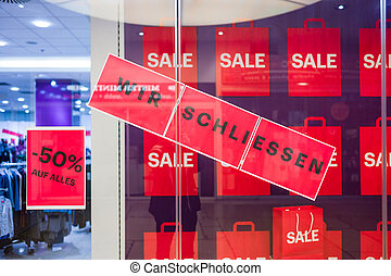 sign: quot;we concludequot; - a shop in a shopping center is...