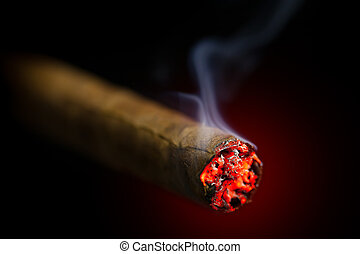 burning cigar on red glowing background
