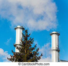 industry chimney with tree - chimney of an industrial...