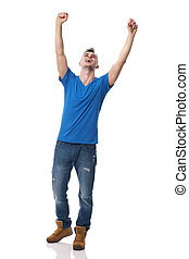 Young happy man celebrating success