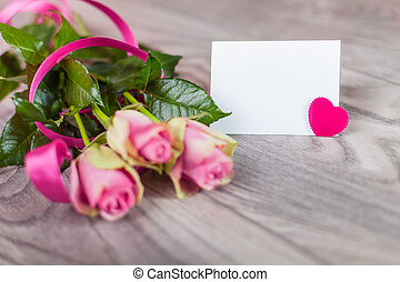 Valentine card with roses on wood