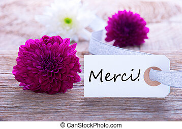 Label with Merci - Label with the French Word Merci which...