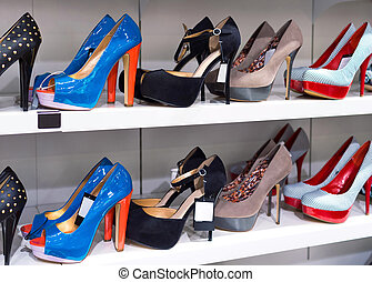 Background with shoes on shelves of shop