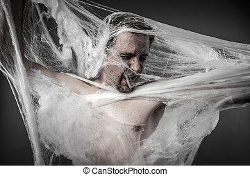 Danger man tangled in huge white spider web