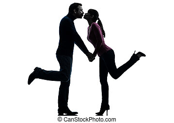 couple woman man lovers kissing silhouette - one caucasian...