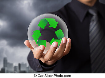 recycle sign in crystal ball - Business people holding...