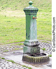 metal standpipe in the park - green metal standpipe in the...