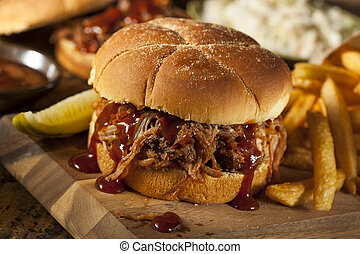 Barbeque Pulled Pork Sandwich with BBQ Sauce and Fries