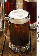 Cold Refreshing Root Beer with Foam in a Mug