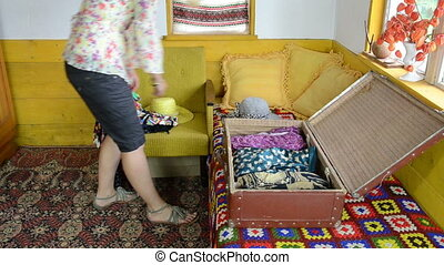 woman prepare travelling - Woman put her dresses and other...