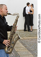 Romantic Jazz - A street musician playing his saxophone...