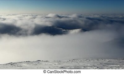 Big mountain over clouds form in a