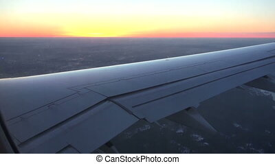 passenger airplane wing  and evening sunset