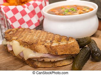 Delicious ham, pork and swiss cheese panini with vegetable...