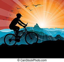 Silhouette of the biker, with mountains and sunset in the...