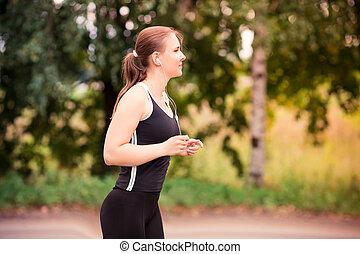 Runner woman jogging in nature outdoor