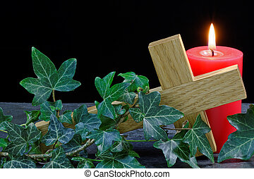 Fallen Cross and Candle - Candle and cross on slate with...