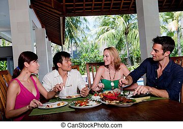 Lunch On Vacation - A group of four adults enjoying lunch at...