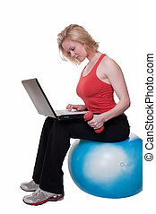 Multi tasking - Attractive blond woman wearing workout...