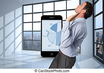 Composite image of businessman standing with arms pushing up...