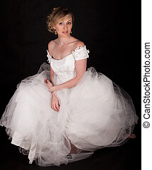 Wedding gown - Attractive blond woman wearing white wedding...