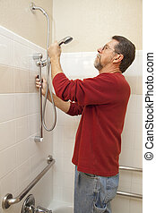 Water Saving Shower - Plumber installing new shower handicap...