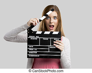 Beautiful girl holding clapboard - Beautiful blonde woman...