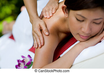 Outside Massage - A young woman enjoying a massage outside