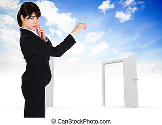 Composite image of thoughtful businesswoman pointing -...