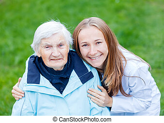 Elderly care - Portrait of elderly woman and her caregiver