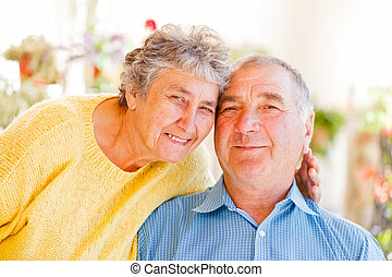 Elderly couple - The portrait of a happy elderly couple