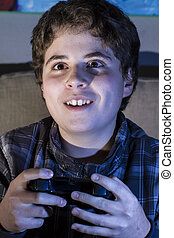 Fun boy with joystick playing computer game at home. - Fun...