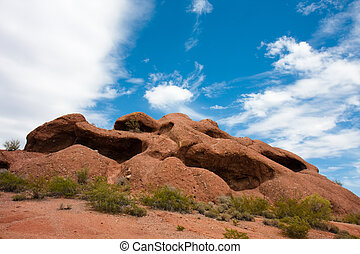 Hole-in-the-rock butte - Red sandstone butte located in...