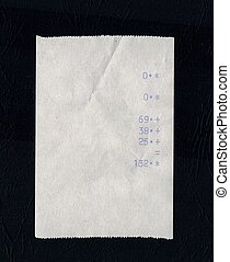 bill or receipt isolated over black background