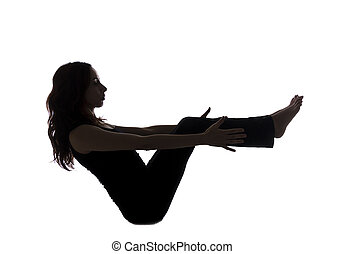 Boat pose, silhouette - Young woman in boat pose, silhouette...