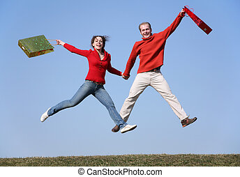 jump couple with bags