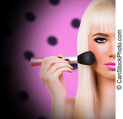 Blonde girl with make up brush - Beautiful blonde girl with...