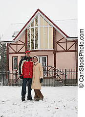 couple and winter house