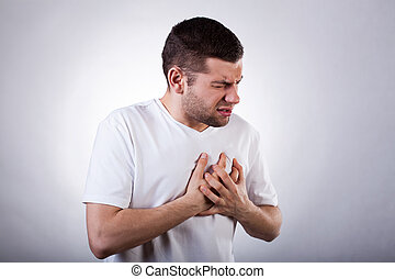 Strong heart attack - Young man in white t-shirt with strong...