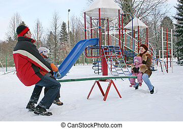 winter family on seesaw