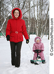mother with baby on sled