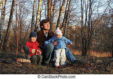 father with children in spring park