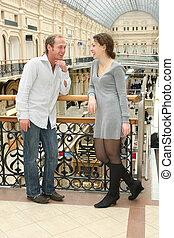 couple in shop passage